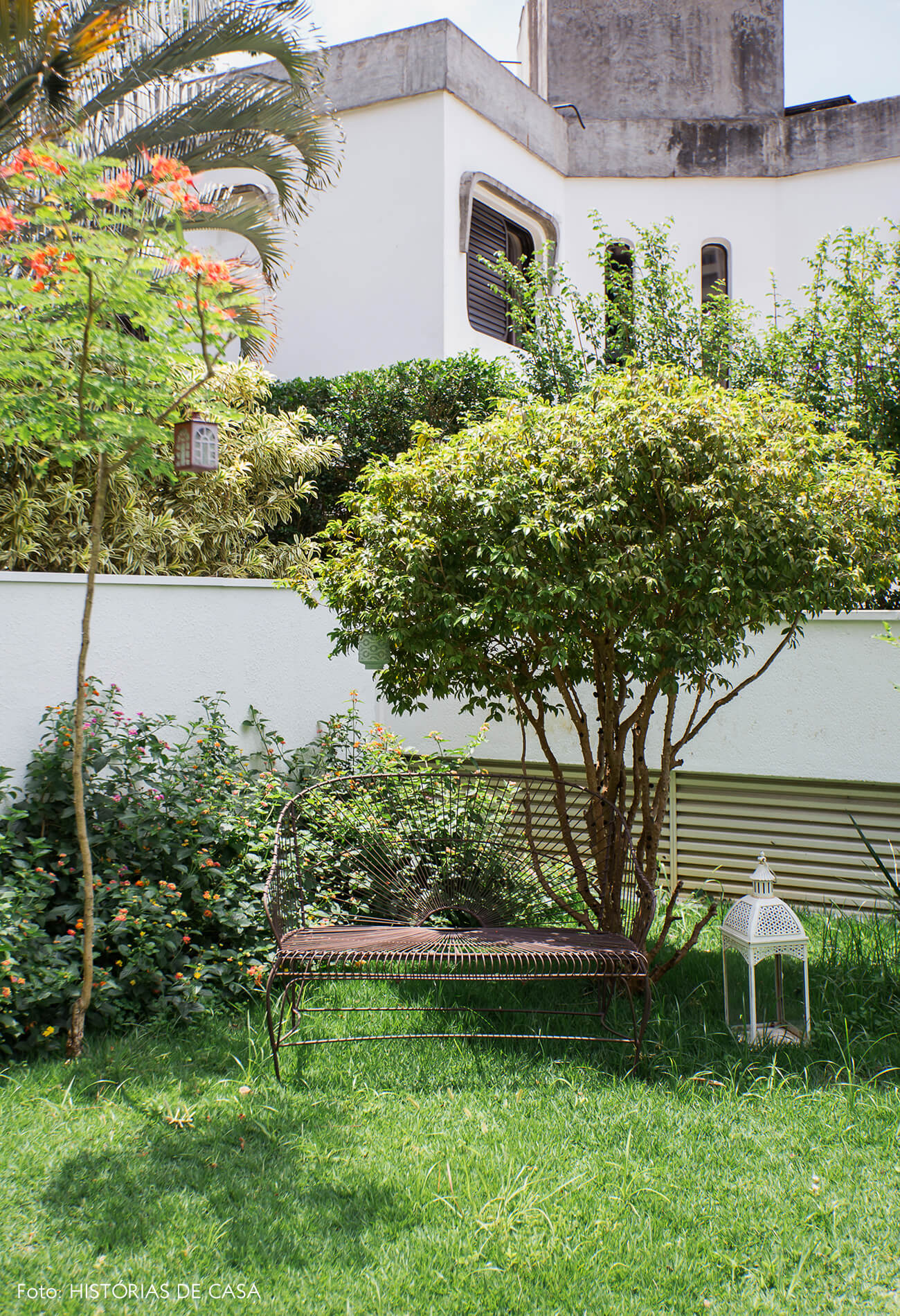 Apartamento térreo com jardim, rede de balanço e plantas