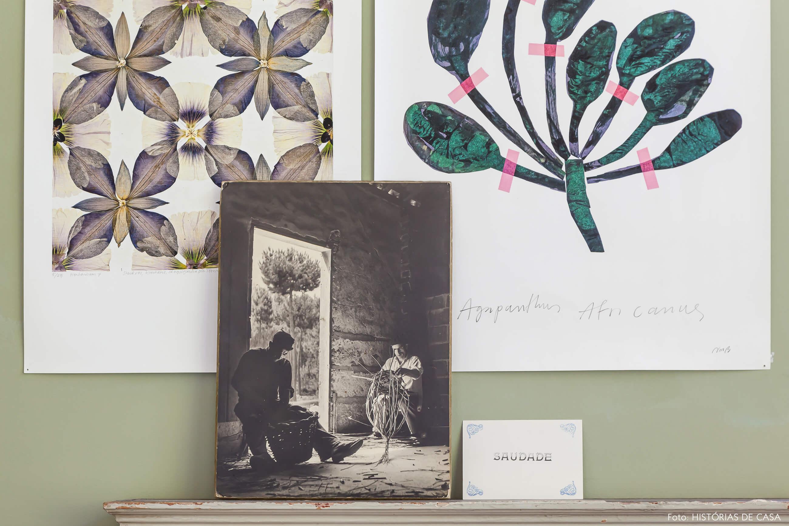 Ap decoração detalhe da parede verde com foto e ilutrações
