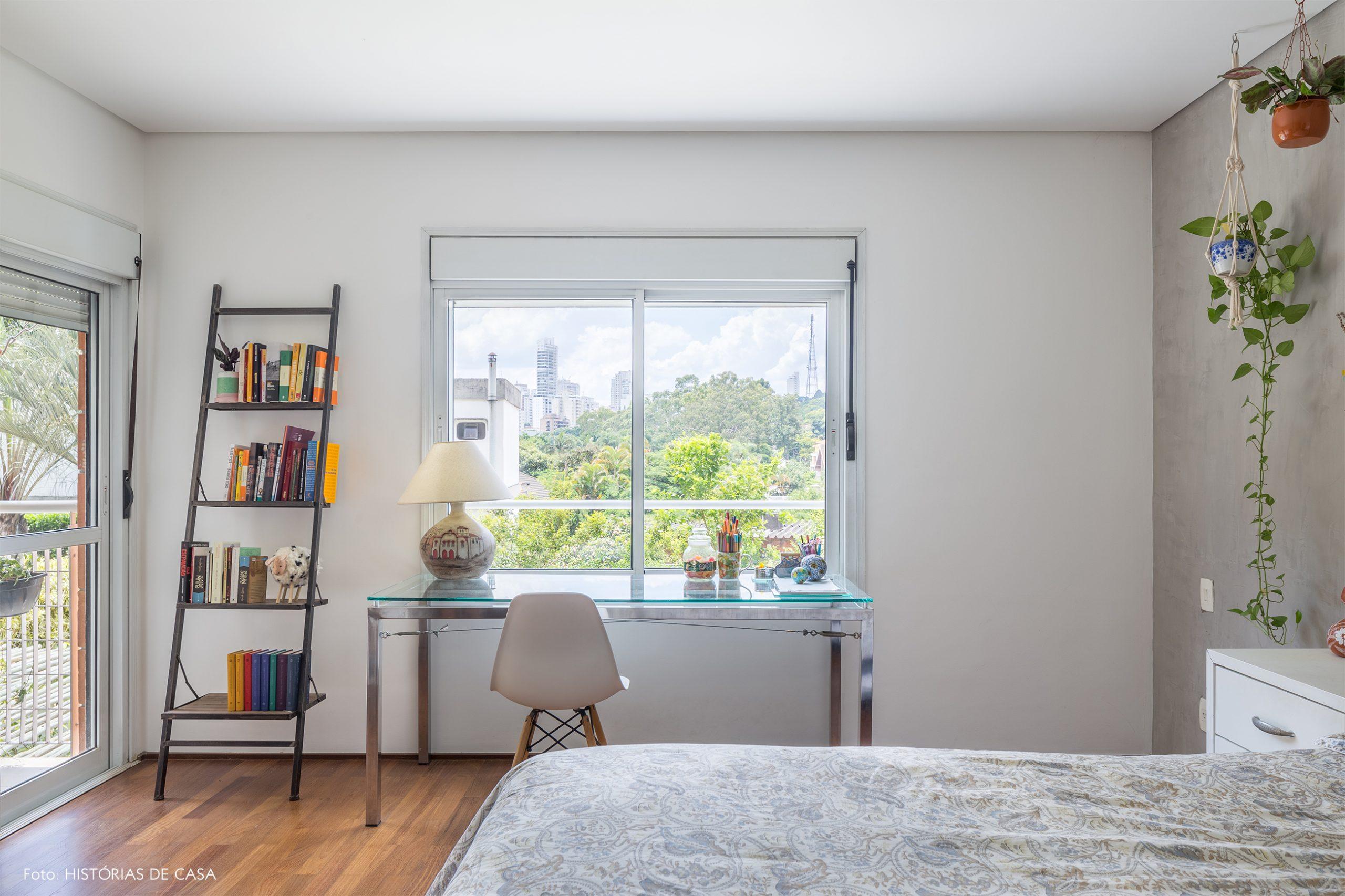 decoração quarto com parede de cimento queimado e cadeira eames
