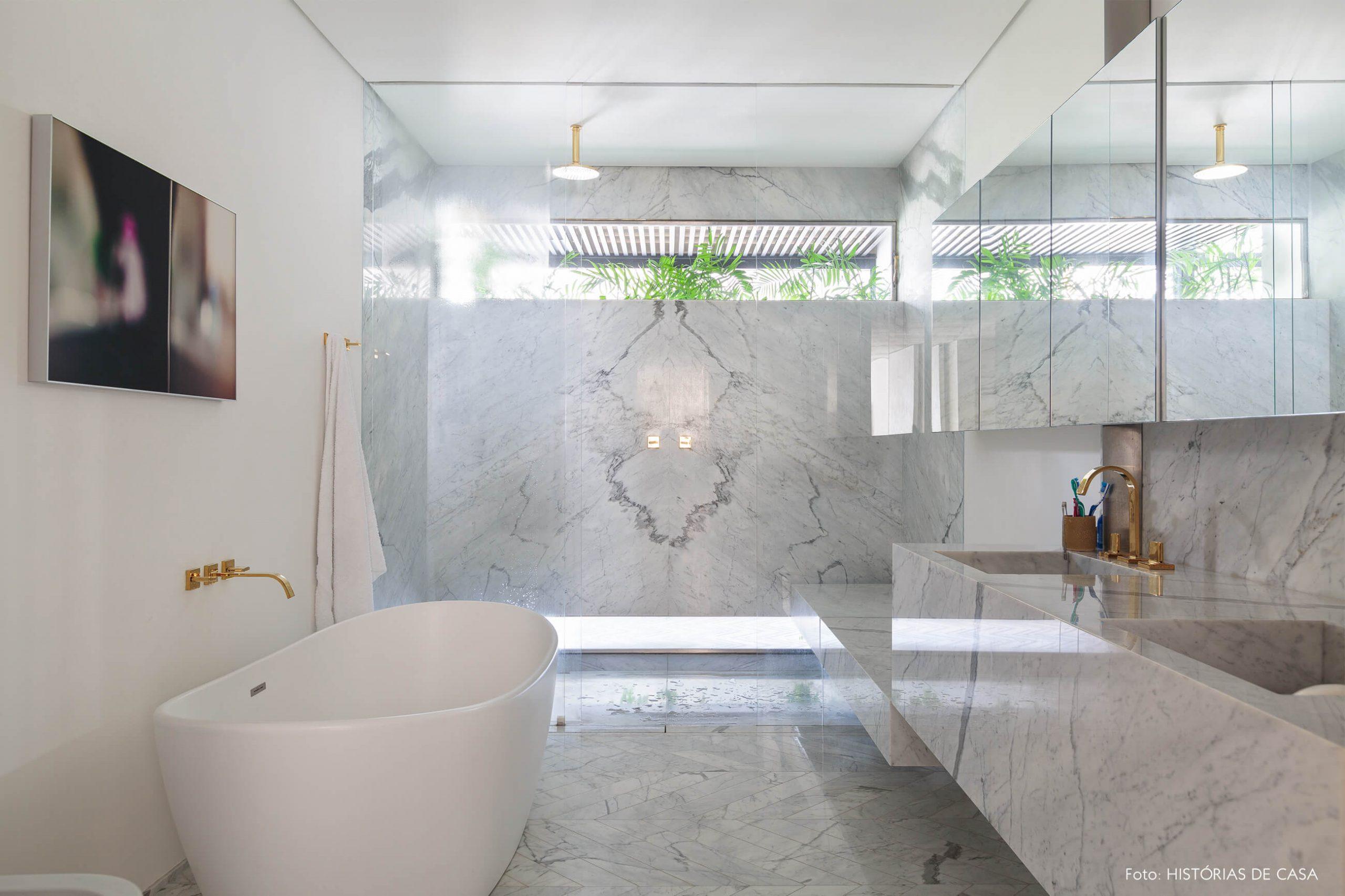 decoração ap banheiro com bancada, piso e parede de marmore