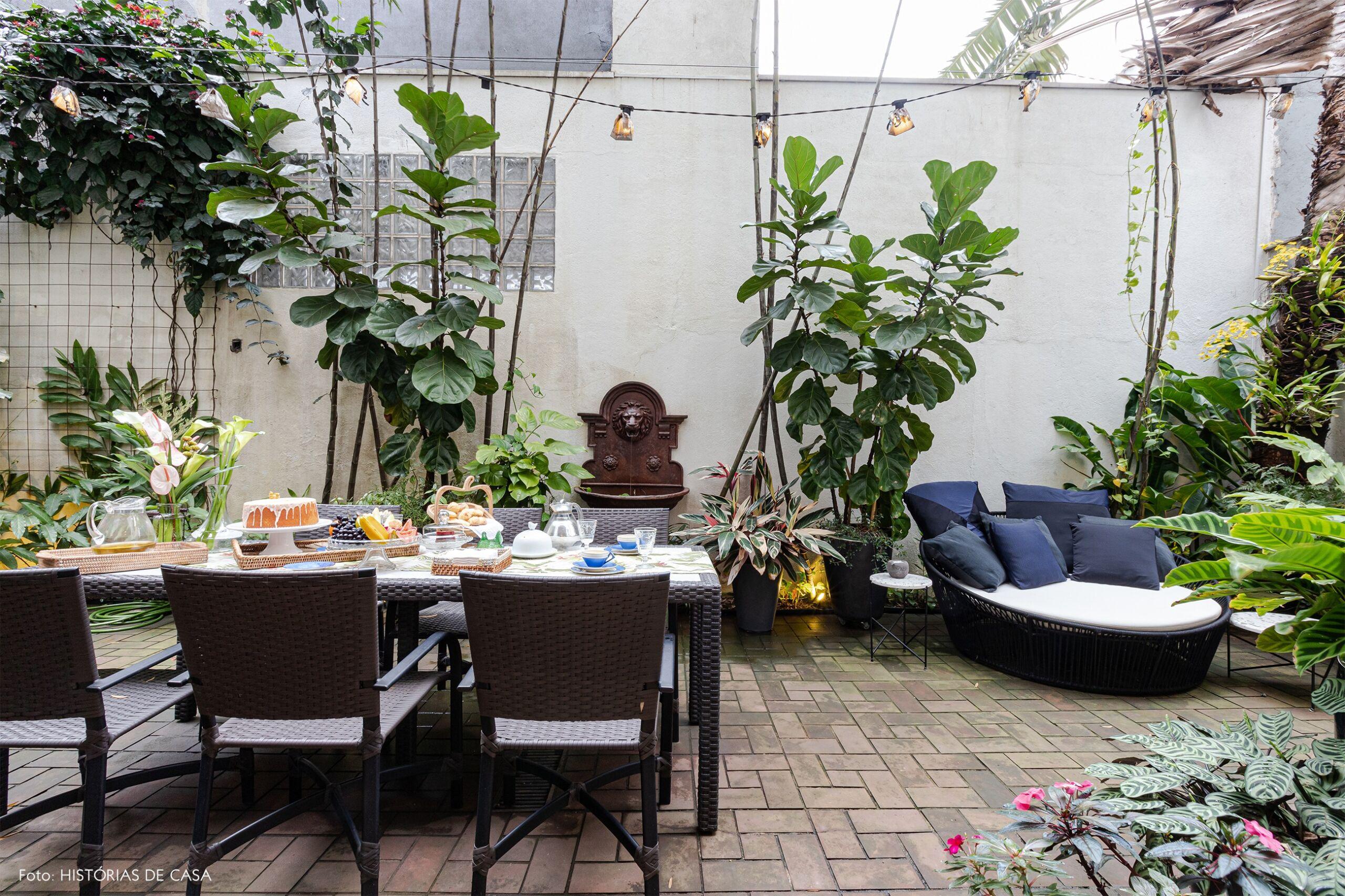 decoração jardim mesa jantar poltrona