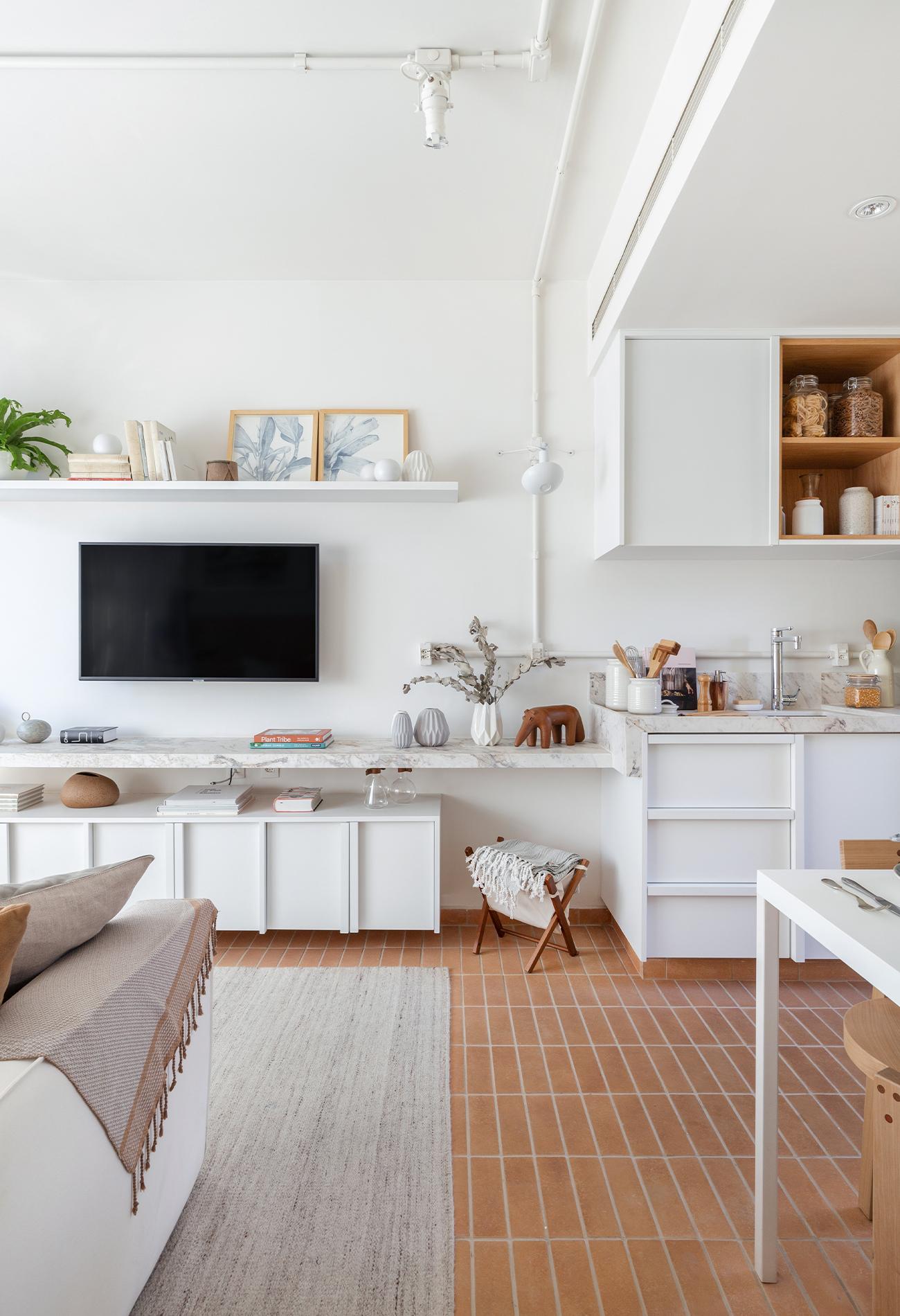 sala de estar integrada com quarto